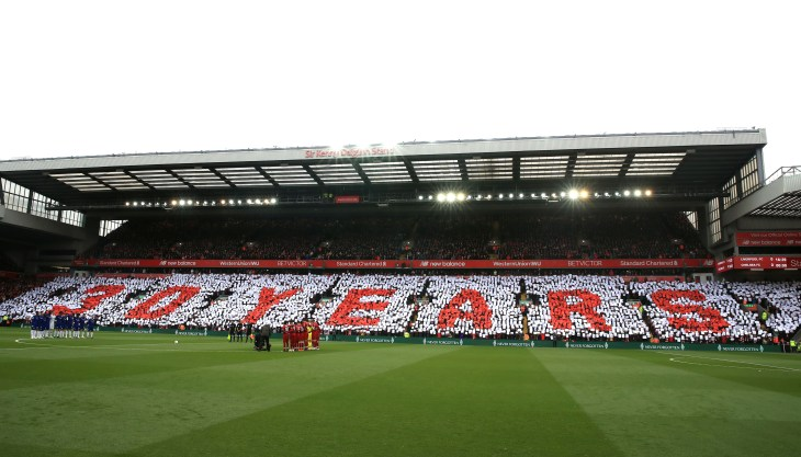 The Liverpool and Chelsea teams stand for a minute's silence to commemorate the 30th anniversary of the Hillsborough disaster before the Premier League match at Anfield