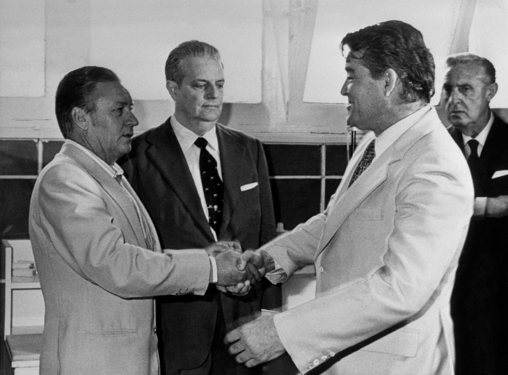 Real Madrid coach Miljan Miljanic (r) shakes hands with successor Luis Molowny (l) after resigning from the club.