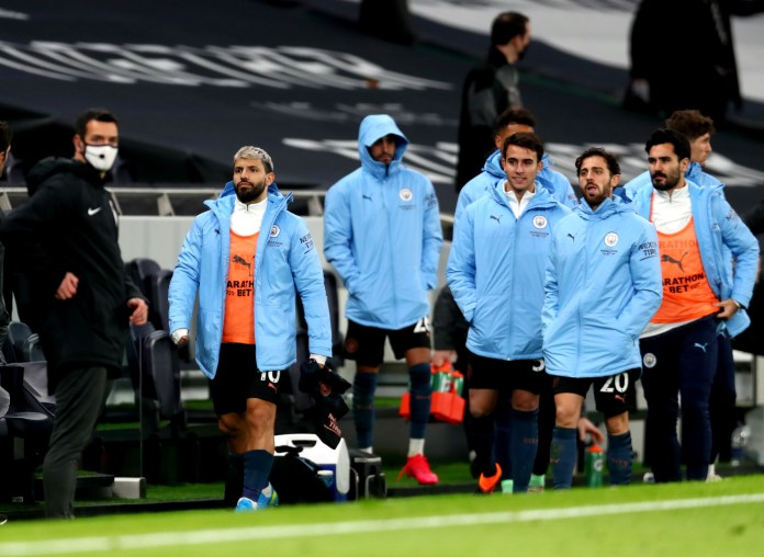 Manchester City's Sergio Aguero, left, remained on the bench for the 2-0 defeat at Tottenham