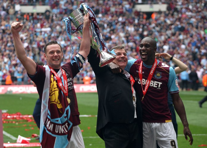 Allardyce, centre, celebrates with the trophy as his West Ham team gain promotion to the Premier League