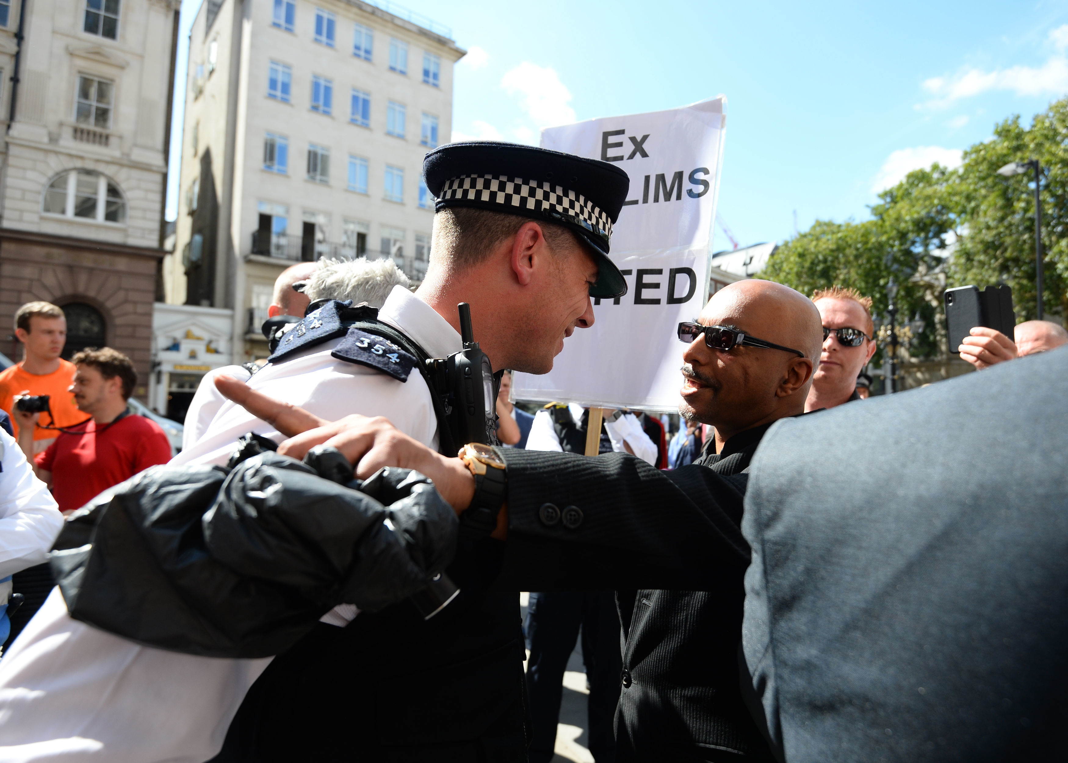 Police get between demonstrators outside the Royal Courts of Justice  Tommy Robinson walks free after court challenge but could still face jail 2