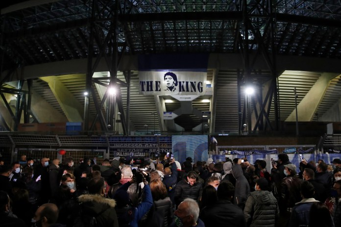 People gather outside Napoli's San Paolo Stadium to remember Diego Maradona