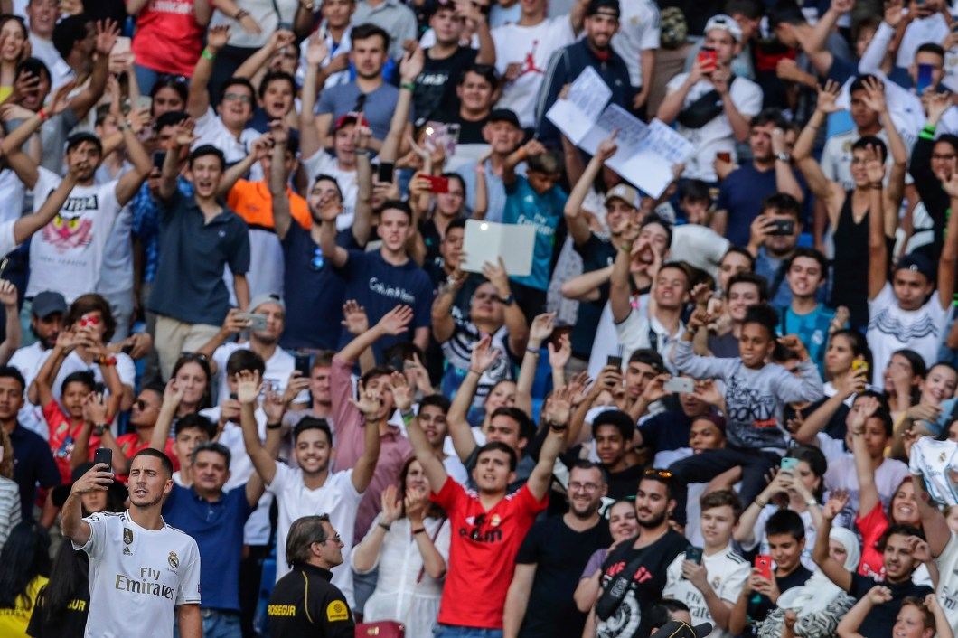 Hazard takes a snapshot with  his phone in front of 50,000 Real Madrid fans at the Bernabeu