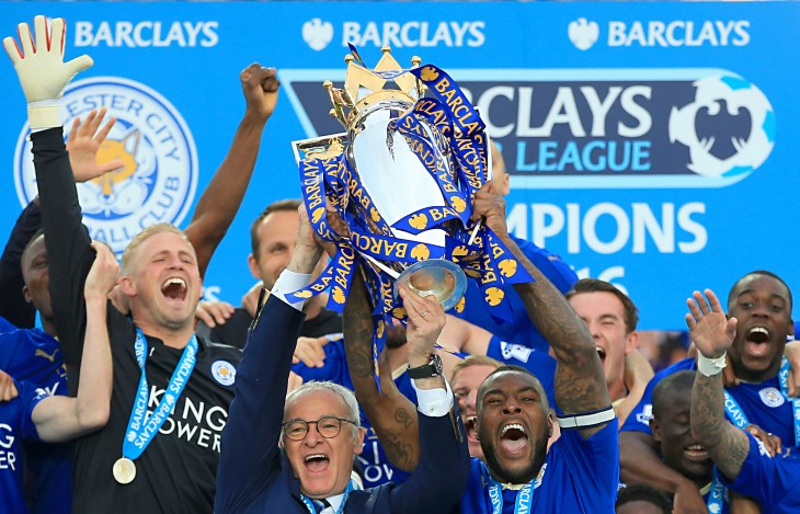 Leicester captain Wes Morgan and manager Claudio Ranieri lift the Premier League trophy. (Nick Potts/PA Images)