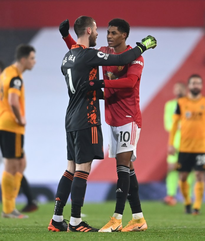 David De Gea hugs Marcus Rashford after his late winner on Tuesday