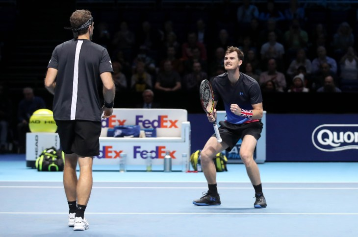 Jamie Murray (right) and Bruno Soares celebrate winning their doubles match (Adam Davy/PA).