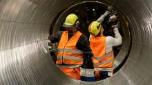 Workers during the production process of pipes at the Nord Stream 2 facility at Mukran on Ruegen Islandon in Sassnitz, Germany.