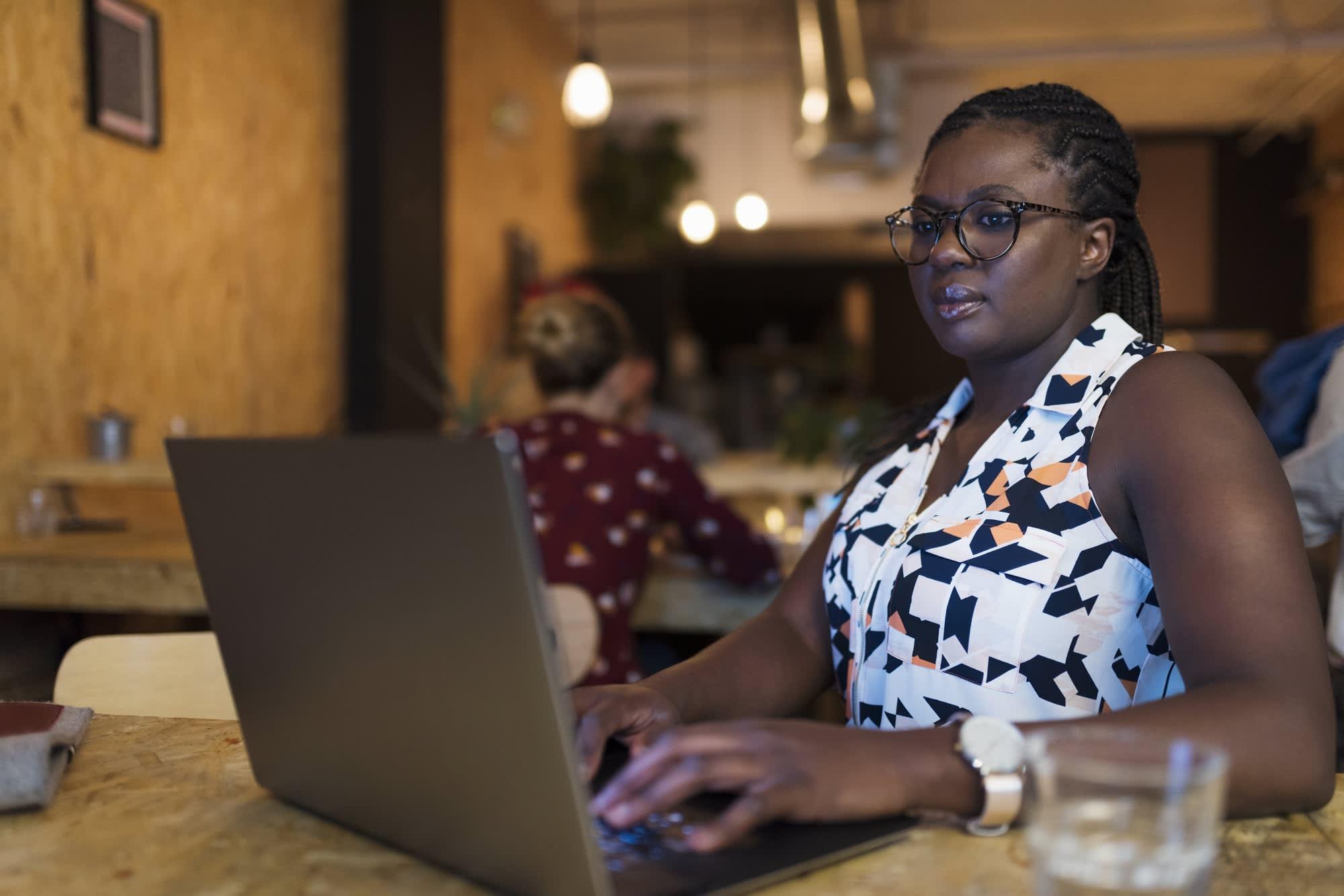 Premium:laptop in cafe