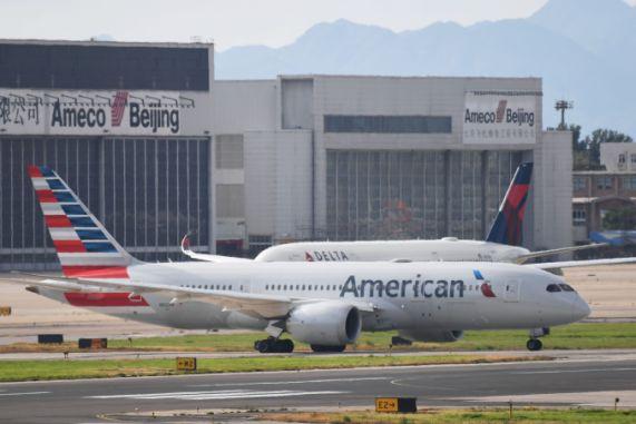 Coronavirus: Pilots union sues to halt American Airlines flights ...