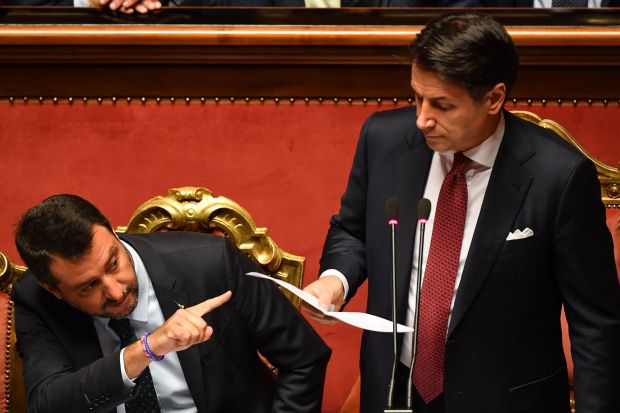 Italian Prime Minister Giuseppe Conte (R), flanked by Deputy Prime Minister and Interior Minister Matteo Salvini (L), delivers a speech at the Italian Senate, in Rome, on August 20, 2019, as the country faces a political crisis.