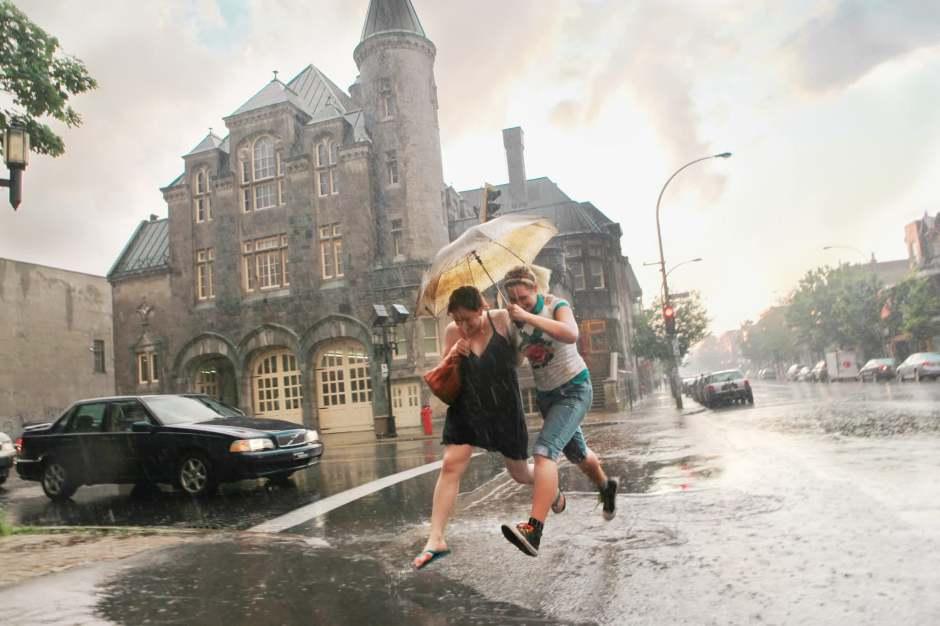 GP: women walking in rain in Montreal, Quebec, Canada