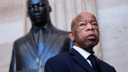 Rep. John Lewis, D-Ga., is seen near the statue of Dr. Martin Luther King, Jr.