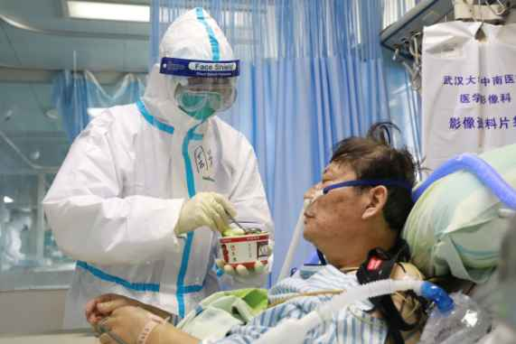 WHO is investigating 1,716 health workers in China infected with ...