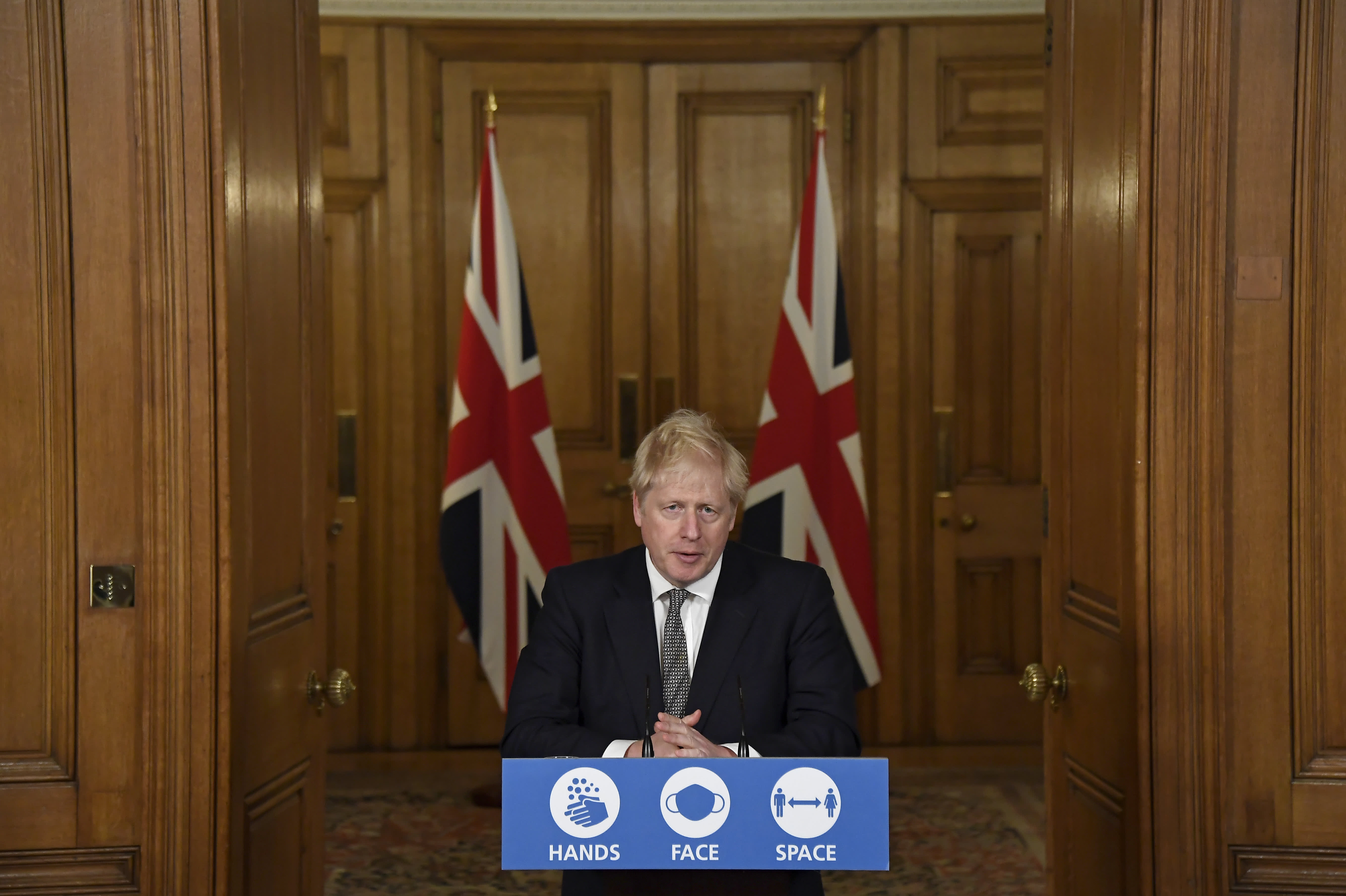 Prime Minister Boris Johnson imposes stay-at-home order in England as coronavirus cases surge