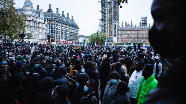 Activists protesting police brutality by the Nigerian Special Anti-Robbery Squad (SARS) demonstrate in Parliament Square in London, England, on October 21, 2020. SARS has been accused of extrajudicial killings, extortion and torture, prompting demonstrations across Nigeria that have seen at least 56 people killed by Nigerian security forces in recent weeks, according to human rights group Amnesty International.