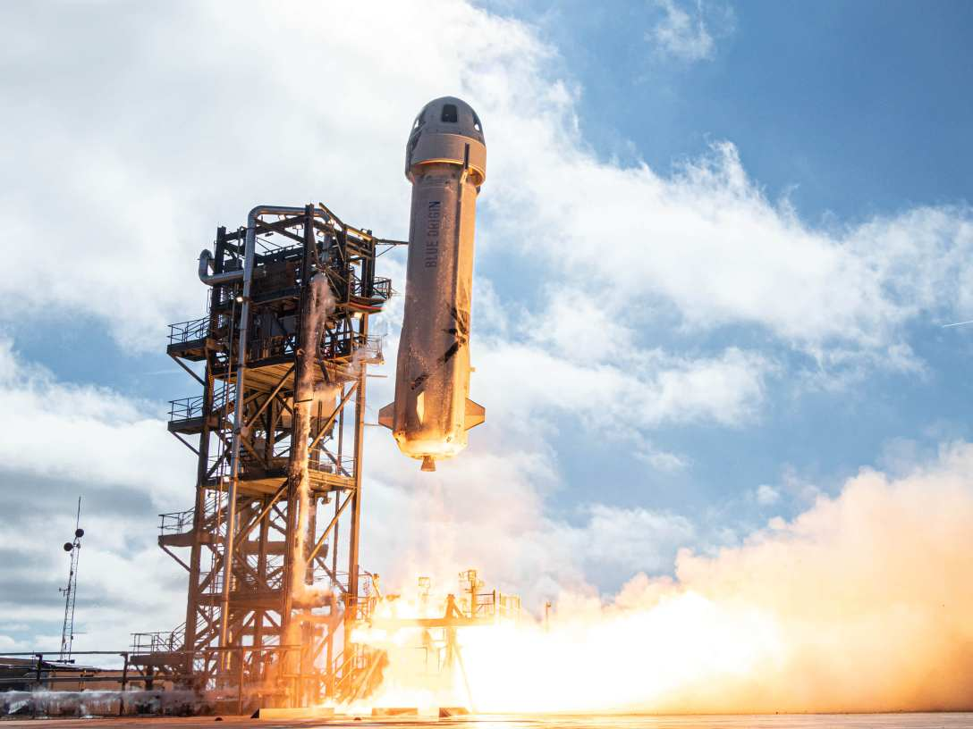 A New Shepard rocket launches on a test flight.