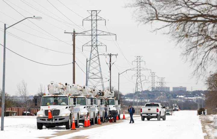 Pike Electric service trucks line up after a snow storm on February 16, 2021 in Fort Worth, Texas. Winter storm Uri has brought historic cold weather and power outages to Texas as storms have swept across 26 states with a mix of freezing temperatures and precipitation.