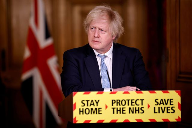 Britain's Prime Minister Boris Johnson gives an update on the coronavirus disease (COVID-19) pandemic during a virtual news conference inside 10 Downing Street, in central London, Britain, March 18, 2021.