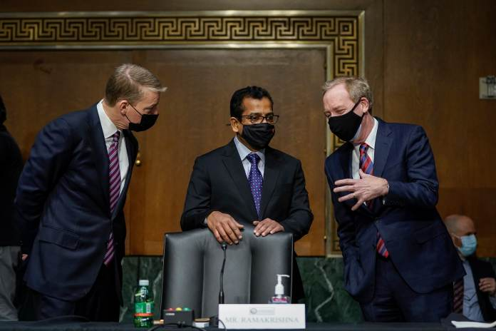 FireEye CEO Kevin Mandia, SolarWinds CEO Sudhakar Ramakrishna and Microsoft President Brad Smith (left to right) talk with each other before the start of a Senate Intelligence Committee hearing on Capitol Hill on February 23, 2021 in Washington, DC. The hearing focused on the 2020 cyberattack that resulted in a series of data breaches within several agencies and departments in the U.S. federal government.