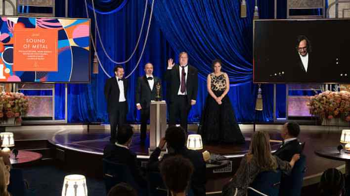 In this handout photo provided by A.M.P.A.S., (L-R) Carlos Cortés, Jaime Baksht, Phillip Bladh and Michelle Couttolenc accept the Sound award for 'Sound of Metal' onstage during the 93rd Annual Academy Awards at Union Station on April 25, 2021 in Los Ang