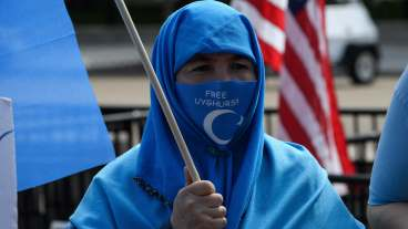 Uyghurs of the East Turkistan National Awakening Movement (ETNAM) hold a rally to protest the 71st anniversary of the People's Republic of China in front of the White House in Washington, DC, on October 1, 2020.