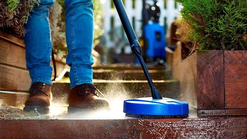 patio with a high pressure cleaner