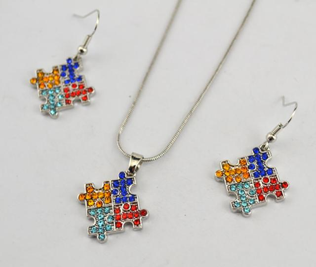 Fashion Rhodium Plated Zinc Studded With Sparkling Crystals Autism Awareness Puzzle Style Charm Pendant Necklace Earring Set From Yxzabc