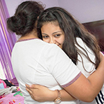 girls hugs her undocumented mother