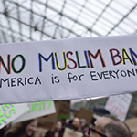 Protest sign reading No Muslim Ban