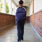 Student walking down hallway