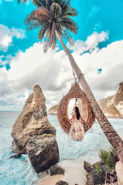 Premium Photo Beautiful Girl On Swing Coconut Palms On Beach At Daimond Beach Nusa Penida Island Bali Indonesia