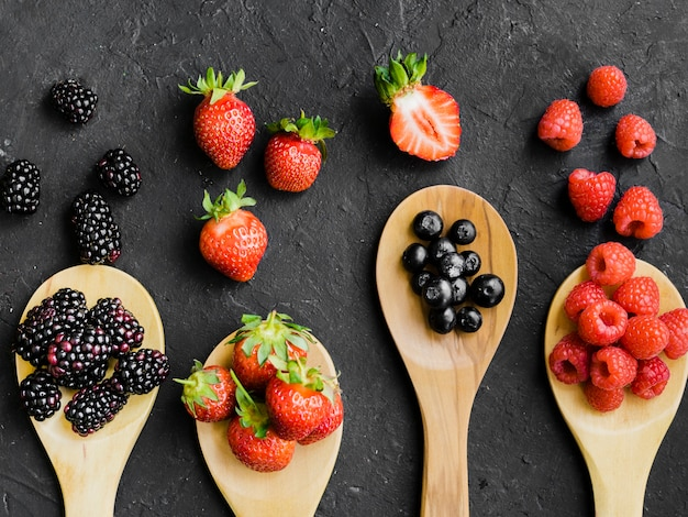 Berries on wooden spoons Free Photo