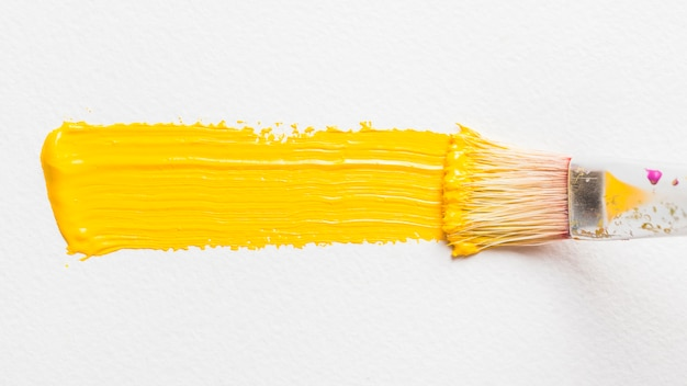 brush painting with yellow