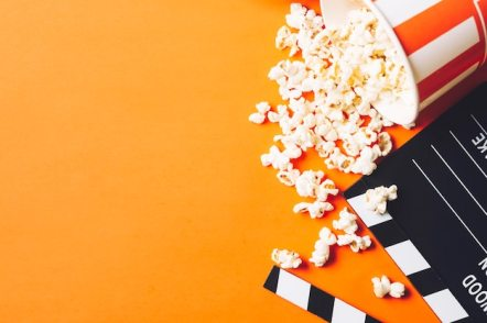 Clapperboard near tasty popcorn Free Photo