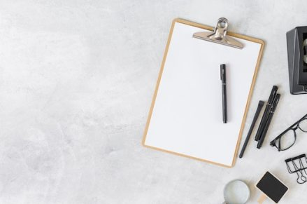 Clipboard and different stationery Free Photo