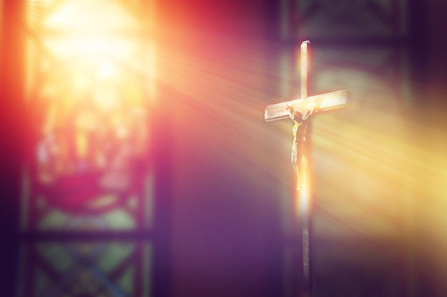 Premium Photo Crucifix Jesus On The Cross In Church With Ray Of Light From Stained Glass