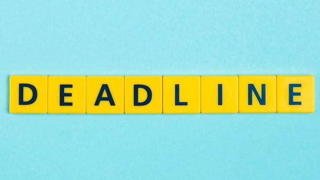Deadline word on scrabble tiles Free Photo