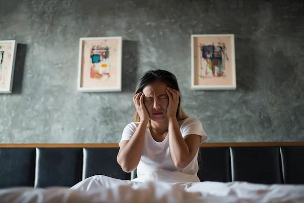 depressed woman with headache