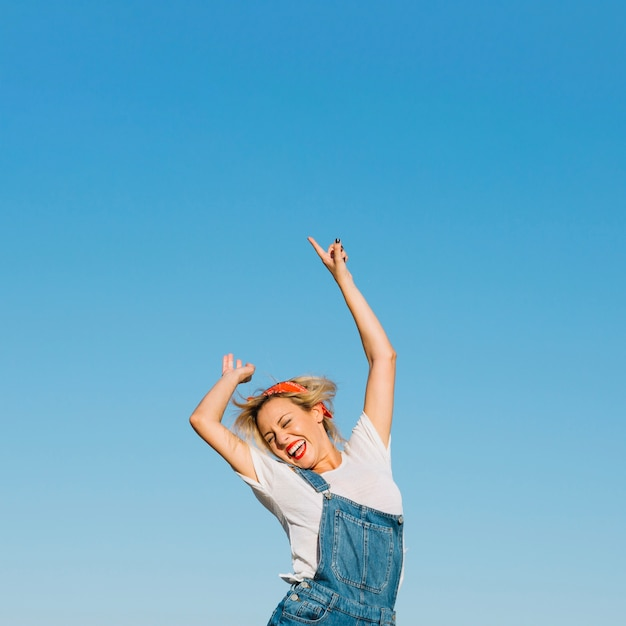excited woman jumping photo