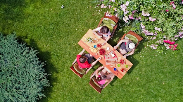 Premium Photo Family And Friends Eating Together Outdoors On Summer Garden Party Aerial View Of Table With Food And Drinks From Above Leisure Holidays And Picnic Concept