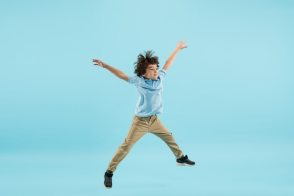 Flying, jumping high. childhood and dream about big and famous future. Free Photo