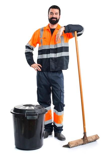 Worker cleaning his work area - Toolbox Talks on Housekeeping