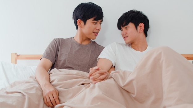 Free Photo   Handsome asian gay couple talking on bed at home. young asian lgbtq+ guy happy relax rest together spend romantic time after wake up ...
