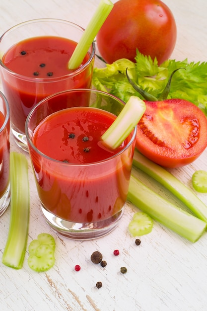 Healthy drink - tomato juice sprigs of celery and half a ...