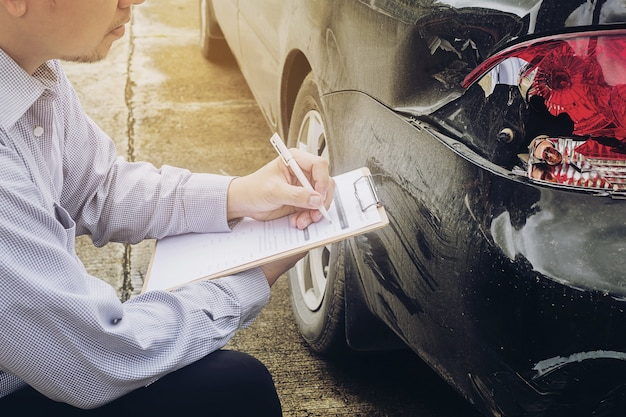 Insurance agent working on car insurance claim process