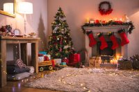 Living room with fireplace and christmas tree Photo | Free ...
