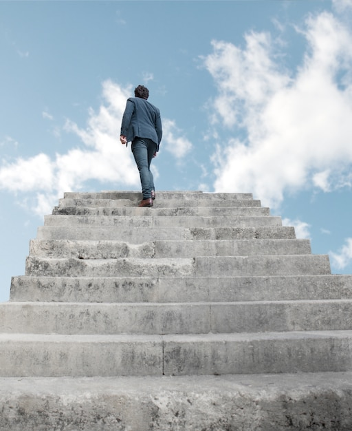 man climbing stairs to