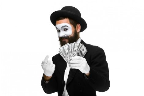 Mime as businessman luring money Free Photo