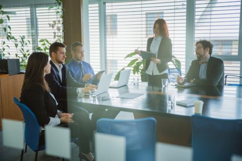 People in office listening to presentation Free Photo