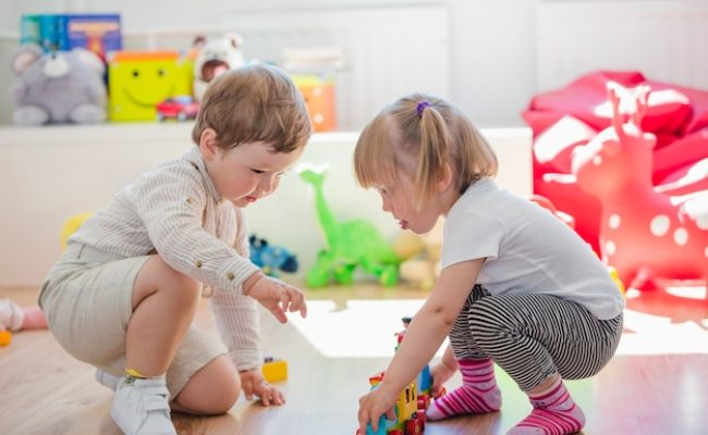 Preschoolers Playing Together In Playroom Photo Free
